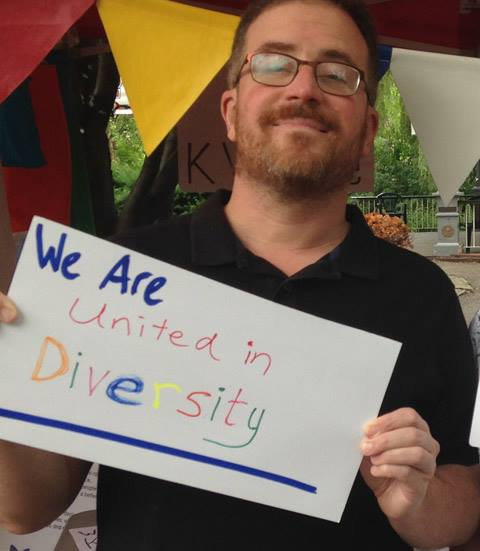 Person holding a We Are sign