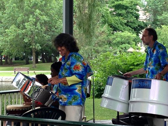 Two performers playing the Steel Pan Drums