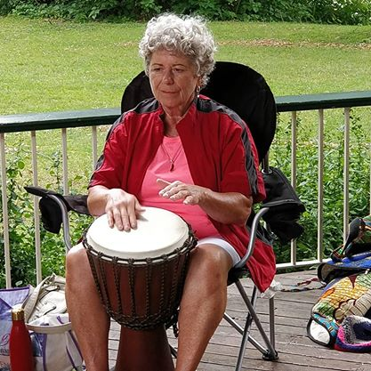 Woman playing the Djembe drum