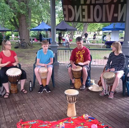 People in the gazebo playing drums