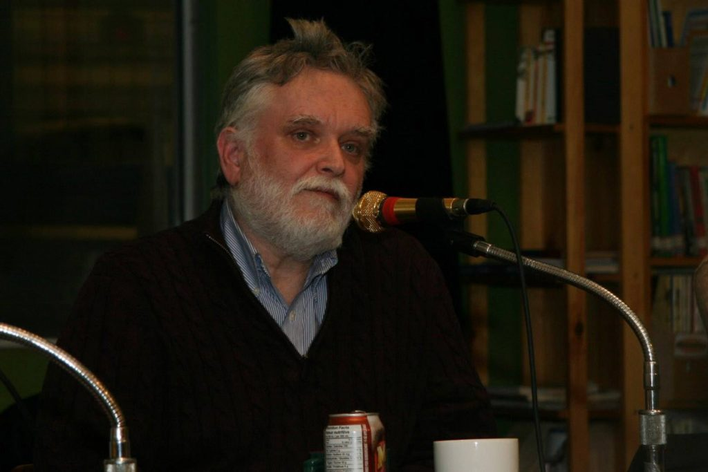 Allan Strong speaks into a microphone