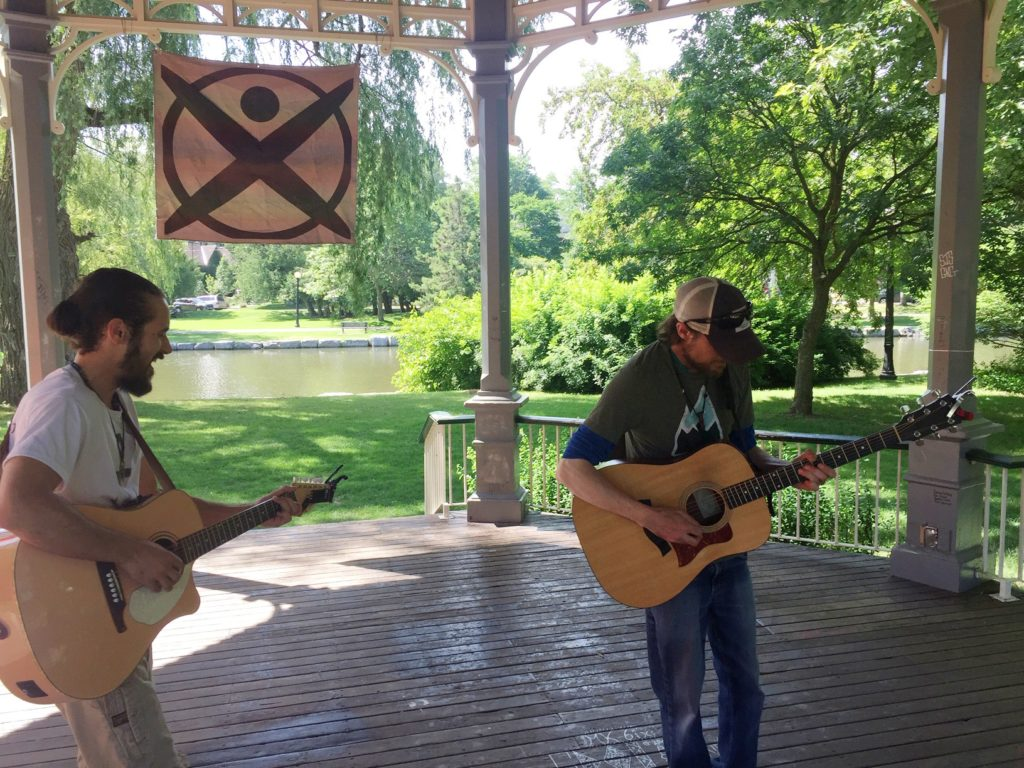 Two men playing guitar in the Gazebo