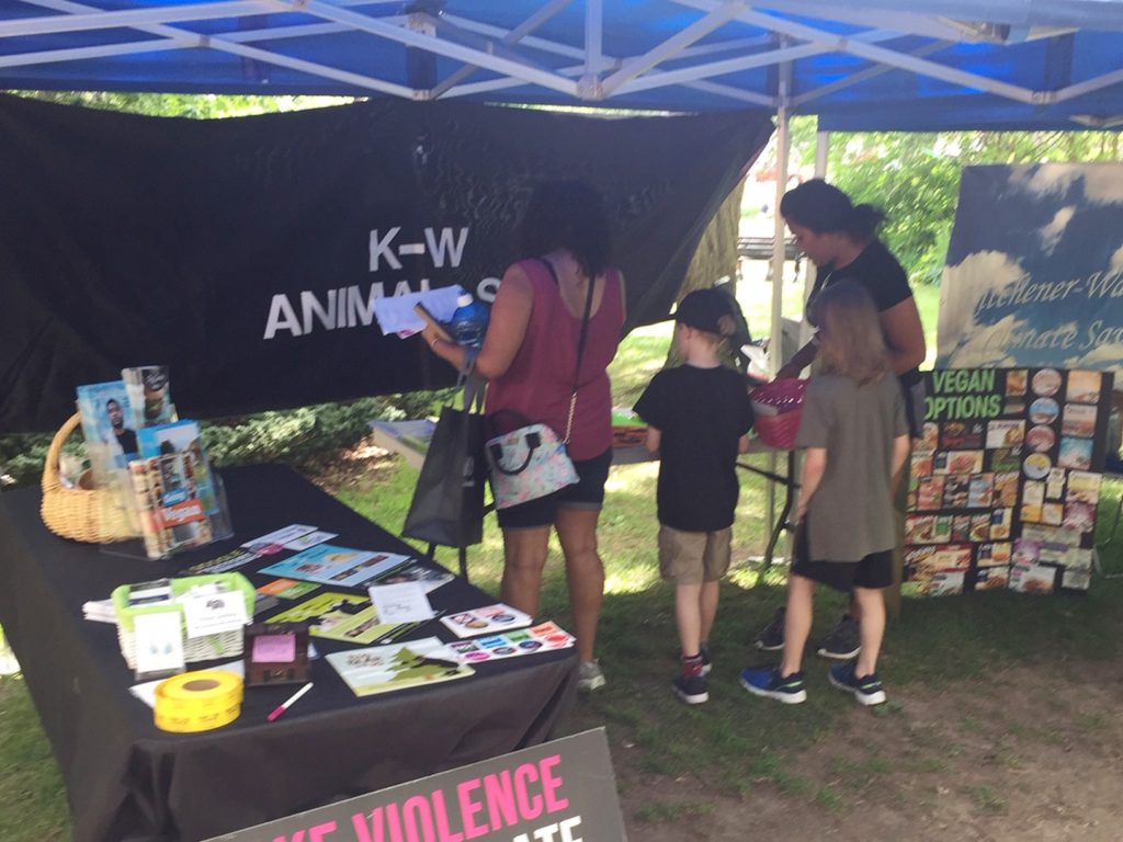 People in the KW Animal Save booth