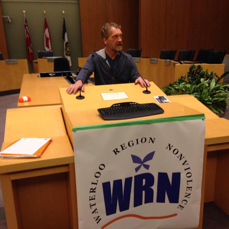 Matt Albrecht at the Kitchener City Hall council chamber podium