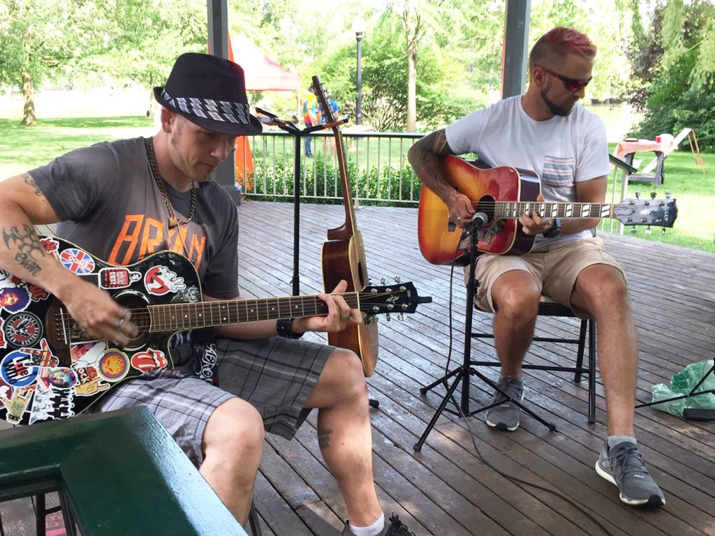 Two people playing guitar in the Gazebo