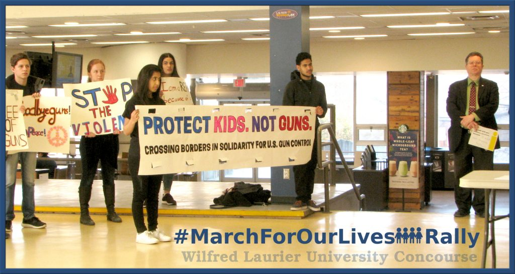 Students holding sign: Protect Kids, Not Guns